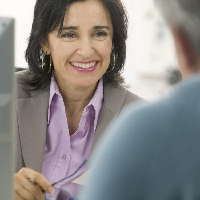 Businesswoman Smiling During Meeting